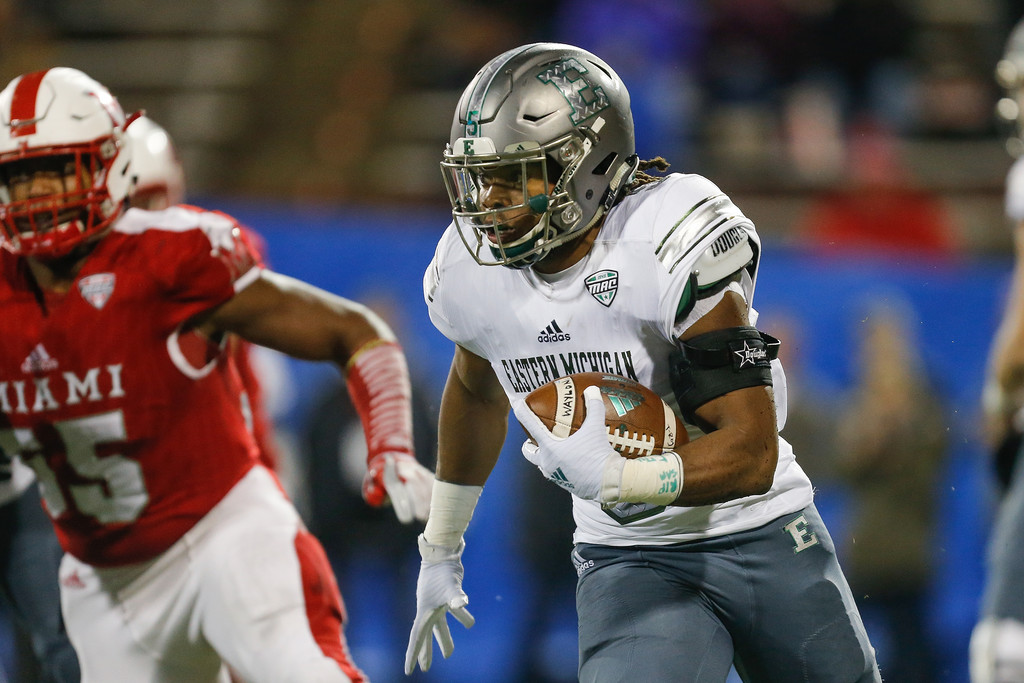Eastern Michigan Eagles running back Shaq Vann carries the ball against the Miami (Ohio) RedHawks