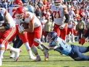 Kansas City Chiefs tight end Travis Kelce breaks out of the grasp of Harold Landry against the Tennessee Titans