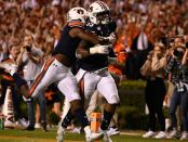 Auburn Tigers linebacker Zakoby McClain after his 100-yard interception return for a touchdown against the Alabama Crimson Tide