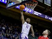 Washington Huskies guard Nahziah Carter dunking the basket against the Arizona Wildcats
