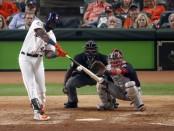 Houston Astros slugger Yordan Alvarez singles against the Washington Nationals in Game One of the 2019 World Series
