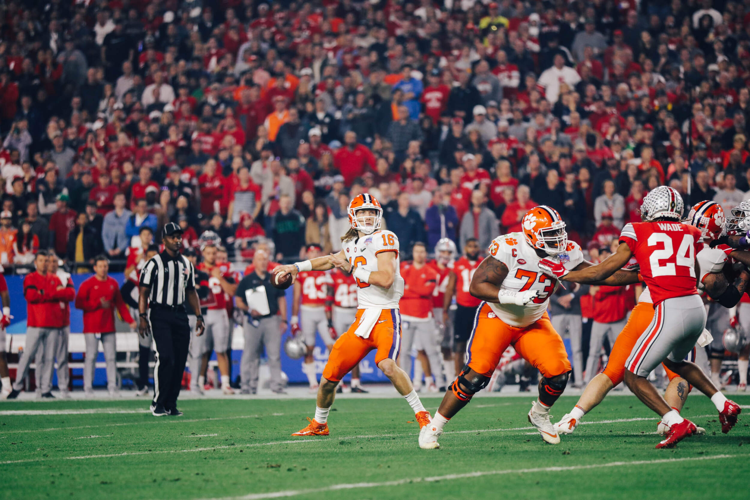 Clemson Tigers quarterback Trevor Lawrence attempts a pass against the Ohio State Buckeyes in the PlayStation Fiesta Bowl in the 2019 College Football Playoff