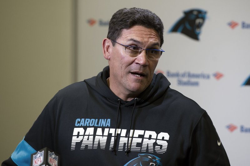 Former Carolina Panthers head coach Ron Rivera speaks to the media following an NFL football game against the Washington Redskins