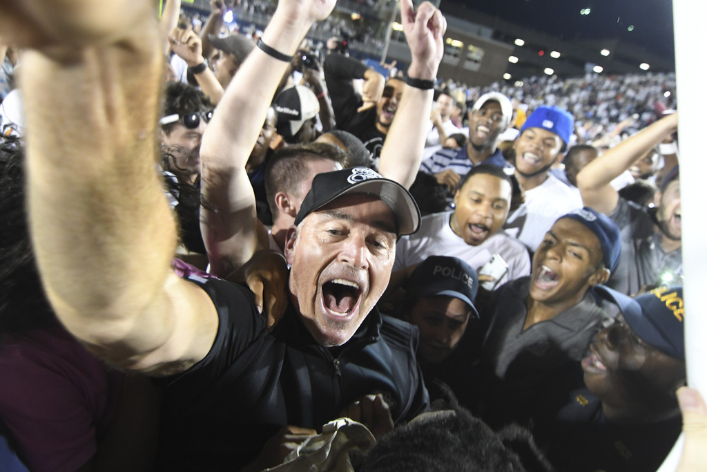 Former Old Dominion Monarchs head football coach Bobby Wilder celebrates a win over the Virginia Tech Hokies