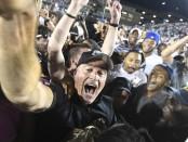 Former Old Dominion Monarchs head football coach Bobby Wilder celebrates a win over the Virginia Tech Hokies