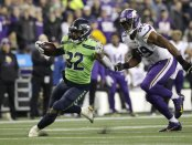 Seattle Seahawks running back Chris Carson carries the ball for a 26-yard gain against the Minnesota Vikings