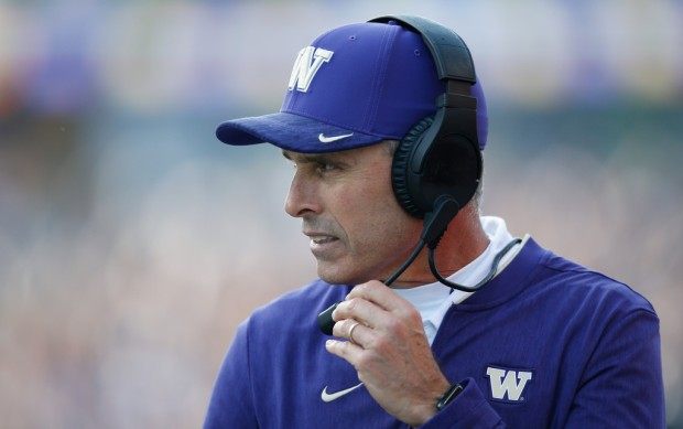 Washington Huskies head football coach Chris Petersen looks on during a game against the Colorado Buffaloes