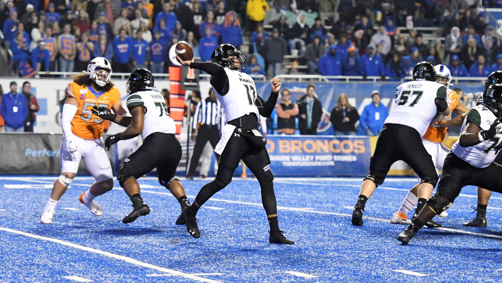Hawai'i Rainbow Warriors quarterback Cole McDonald attempts a pass against the Boise State Broncos