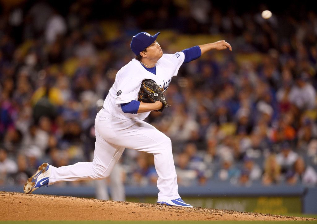 Former Los Angeles Dodgers pitcher Hyun-jin Ryu pitches against the Atlanta Braves