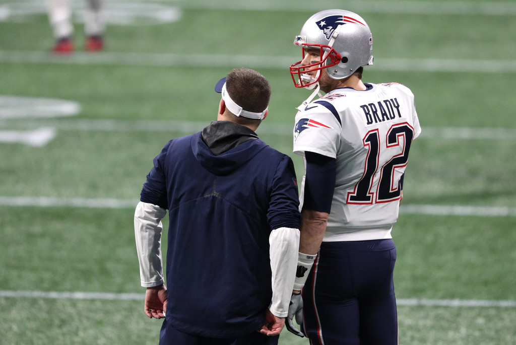 New England Patriots quarterback Tom Brady speaks with offensive coordinator Josh McDaniels before Super Bowl LIII against the Los Angeles Rams