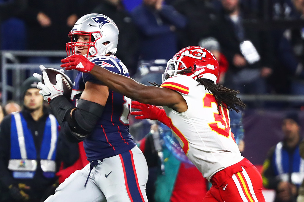 Former Kansas City Chiefs corner back Josh Shaw attempts to tackle Rob Gronkowski against the New England Patriots
