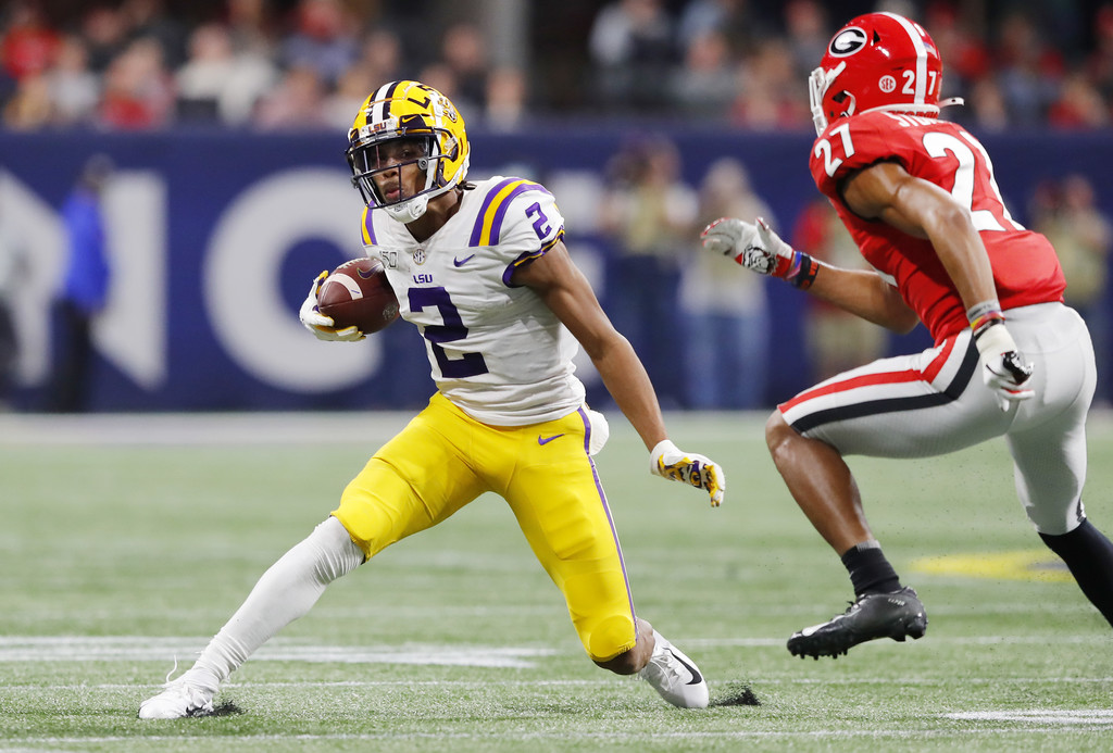 LSU Tigers wide receiver Justin Jefferson runs with the ball after making a reception against the Georgia Bulldogs in the second half of the 2019 SEC Championship game