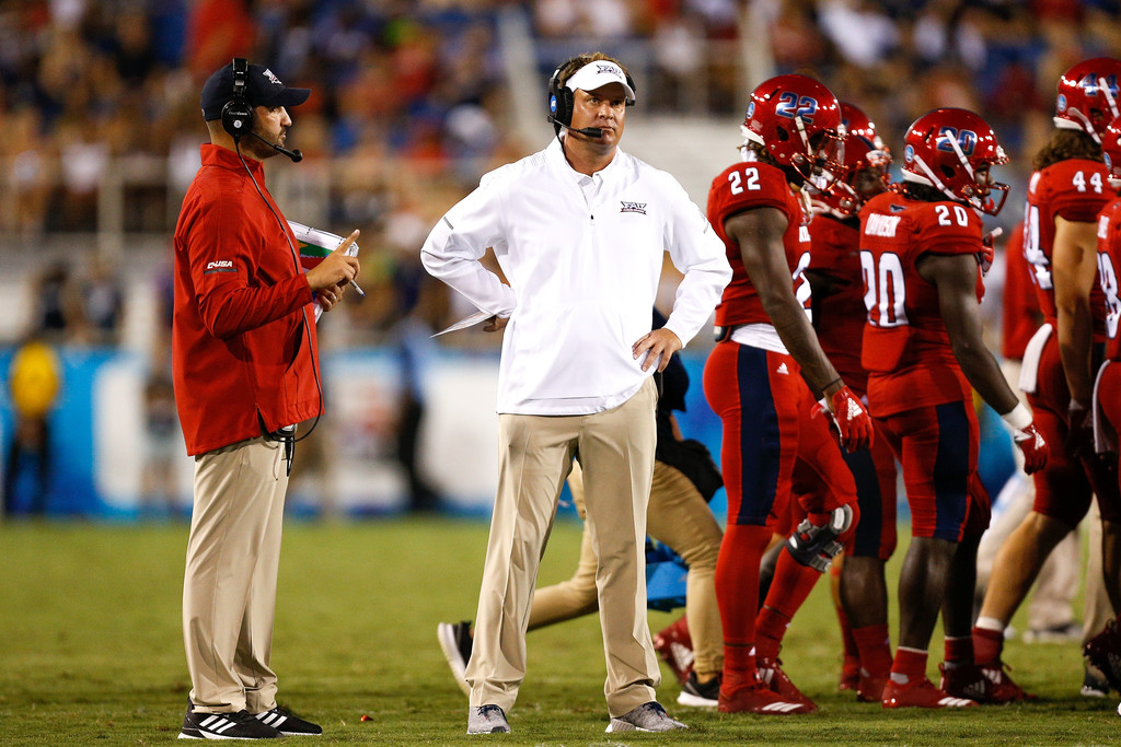 Former Florida Atlantic Owls head coach Lane Kiffin looks on against the Bethune Cookman Wildcats