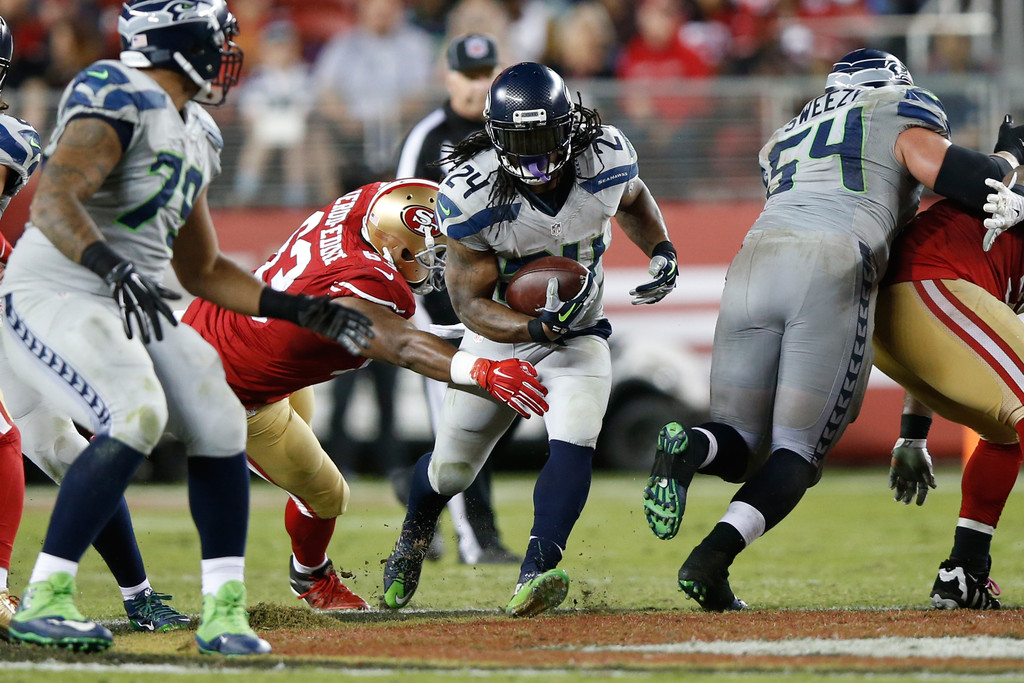 Seattle Seahawks running back Marshawn Lynch carrying the ball against the San Francisco 49ers