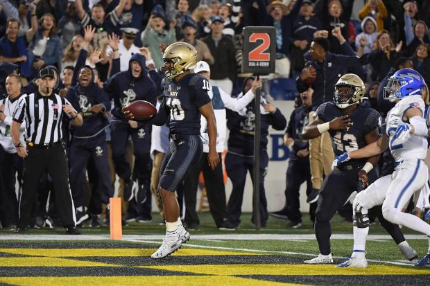 Navy Midshipmen quarterback Malcolm Perry scoring a touchdown against the Air Force Falcons