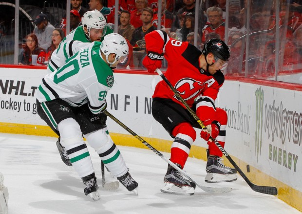 Former Arizona Coyotes winger Taylor Hall plays the puck against the Dallas Stars during the second period