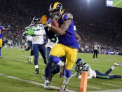 Los Angeles Rams running back Todd Gurley II scores a touchdown against the Seattle Seahawks