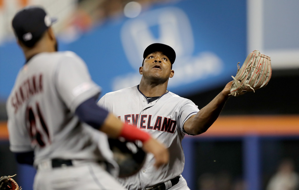 Former Cleveland Indians outfielder Yasiel Puig catches a hit by J.D. Davies against the New York Mets