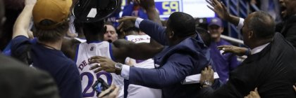 A fight between players spills into the crowd during the second half between the Kansas Jayhawks and the Kansas State Wildcats
