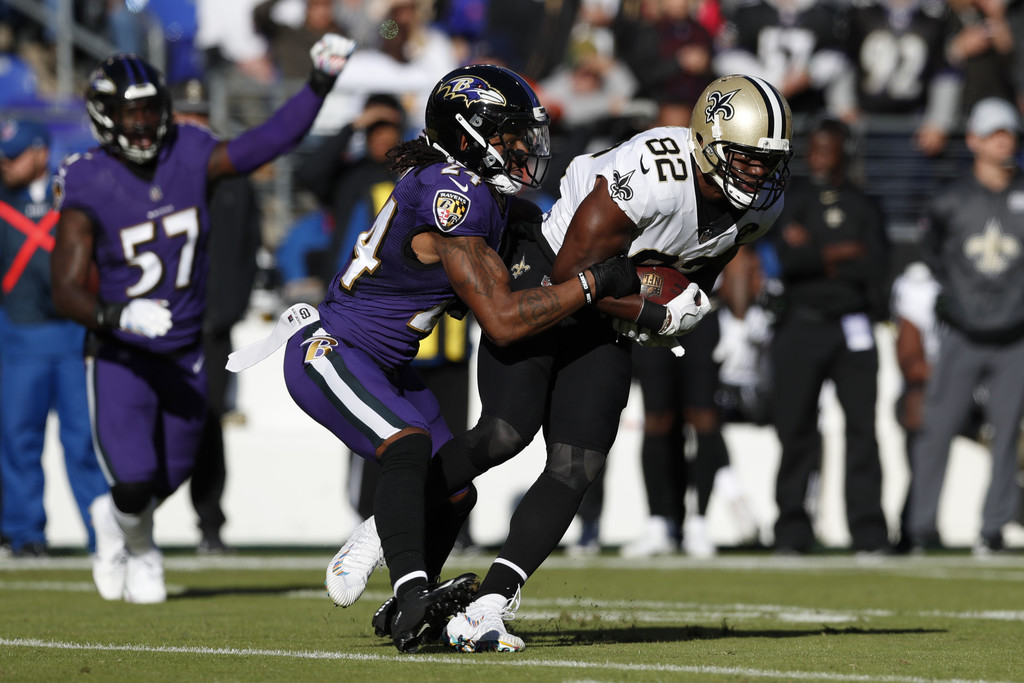 Former New Orleans Saints tight end Benjamin Watson is tackled by Brandon Carr against the Baltimore Ravens