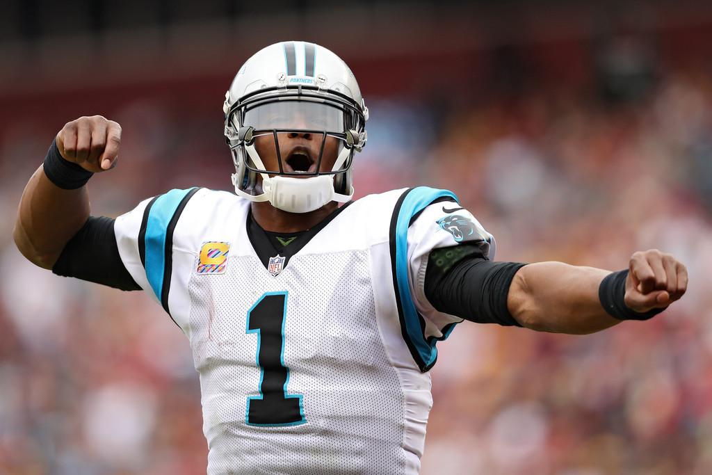 Former Carolina Panthers quarterback Cam Newton celebrates after a play against the Washington Redskins