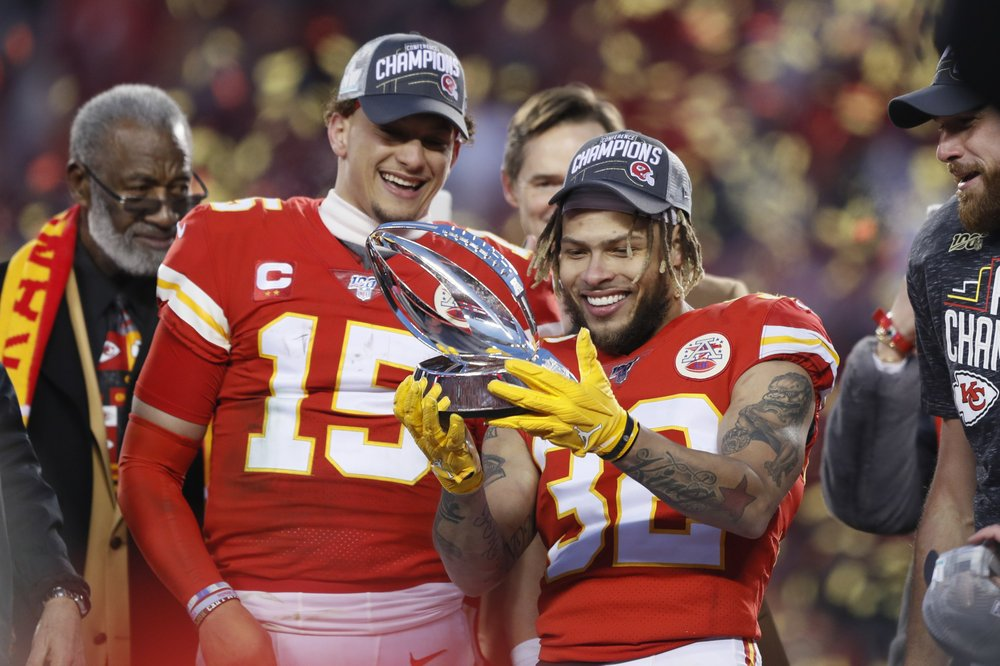 Kansas City Chiefs safety Tyrann Mathieu and Patrick Mahomes hold up the Lamar Hunt Trophy after the NFL AFC Championship football game against the Tennessee Titans
