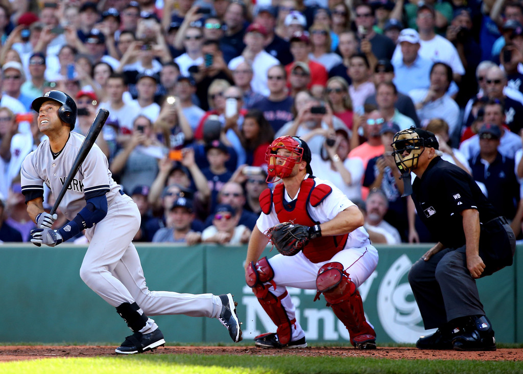 Former New York Yankees shortstop Derek Jeter hits a single in his last career at-bat in the third inning against the Boston Red Sox