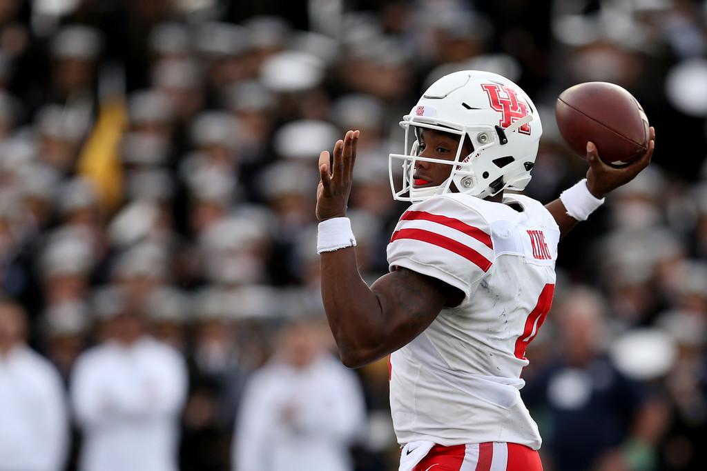 Former Houston Cougars quarterback D'Eriq King throws the ball against the Navy Midshipmen