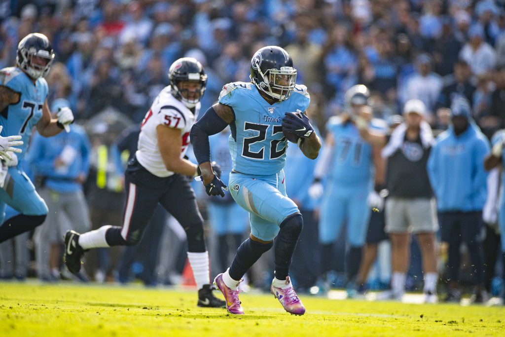 Tennessee Titans running back Derrick Henry runs with the ball against the Houston Texans