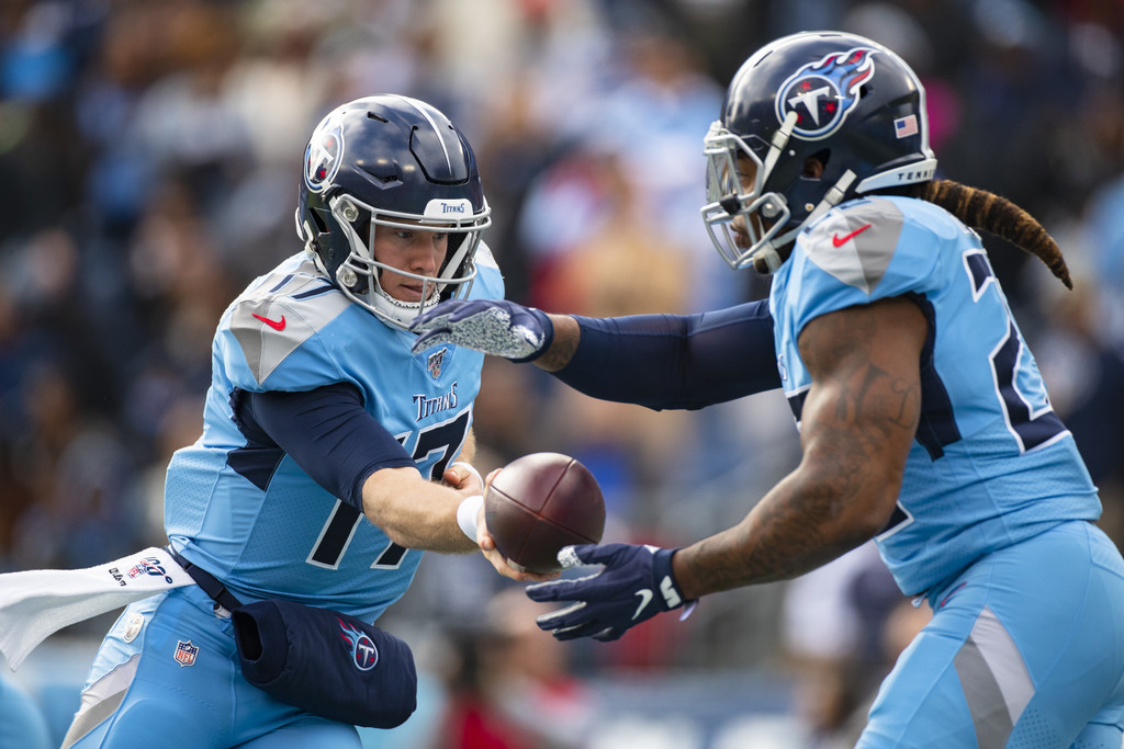 Tennessee Titans quarterback Ryan Tannehill hands the ball off to Derrick Henry against the Houston Texans