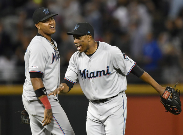 Former Miami Marlins outfielder Curtis Granderson celebrates a win with Starlin Castro against the Chicago White Sox