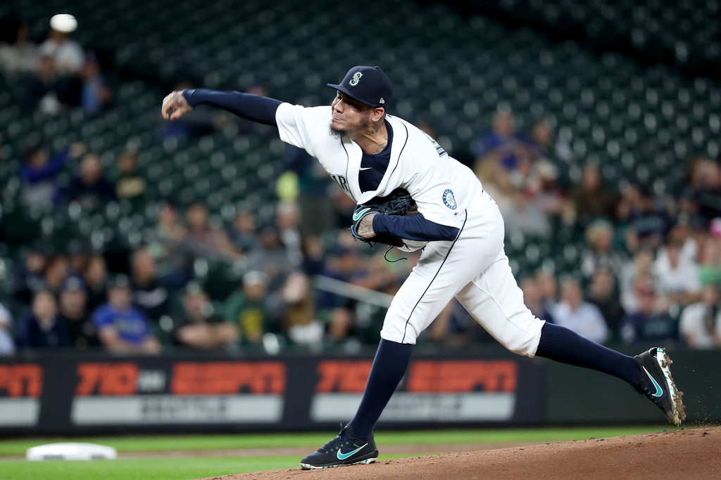 Former Seattle Mariners pitcher Félix Hernández pitches against the Oakland Athletics
