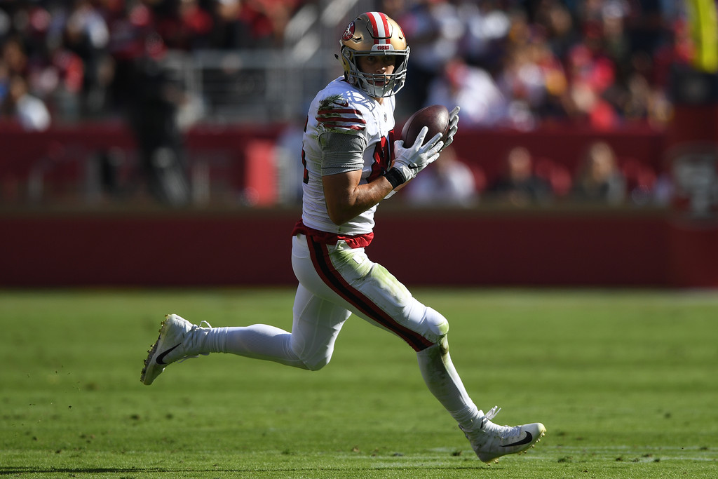 San Francisco 49ers tight end George Kittle runs with the ball after making a reception against the Los Angeles Rams