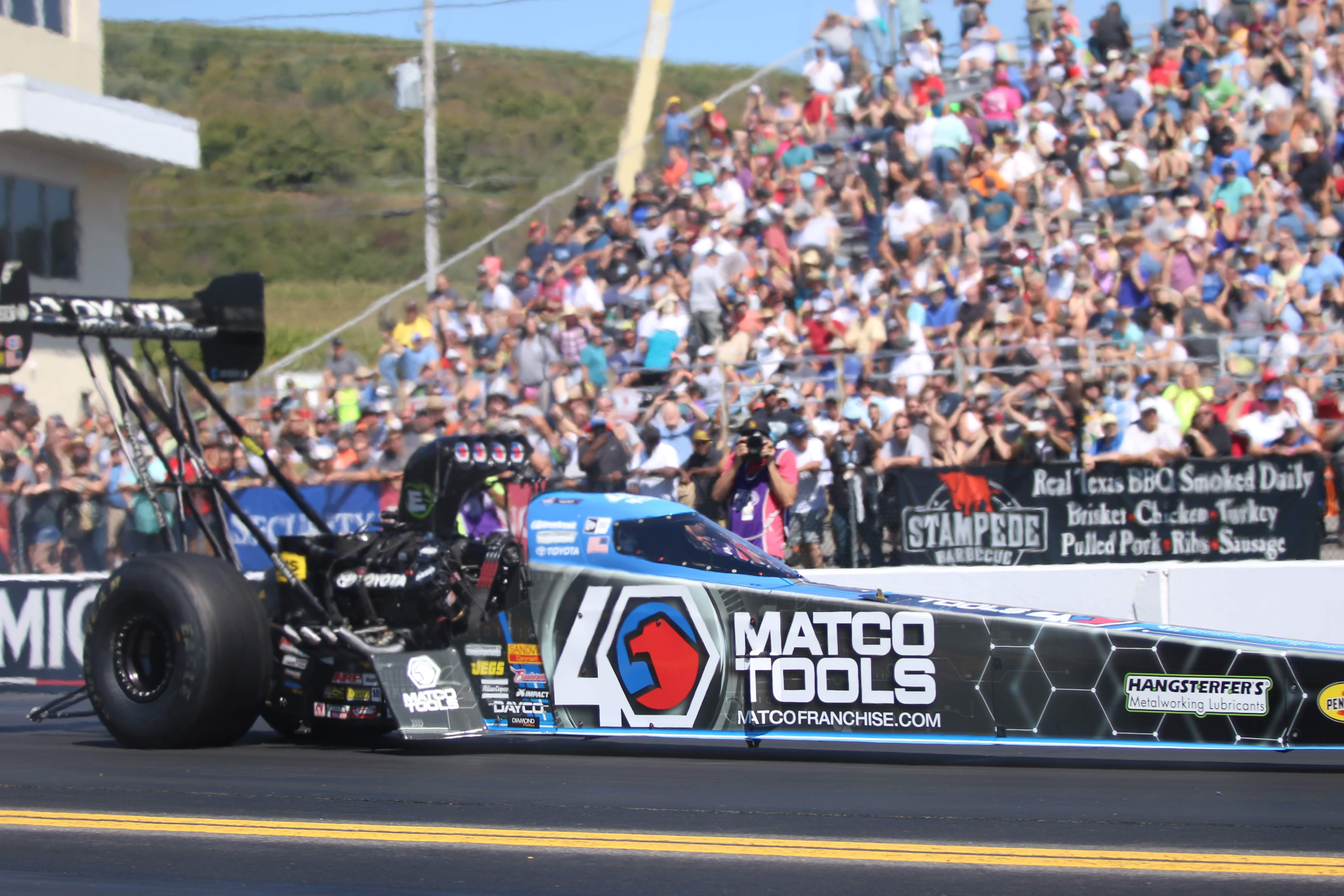 Matco Tools Top Fuel Dragster pilot Antron Brown racing during the Mopar Express Lane NHRA Nationals presented by Pennzoil