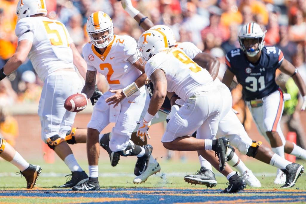 Tennessee Volunteers quarterback Jarrett Guarantano hands the ball off to Tim Jordan against the Auburn Tigers