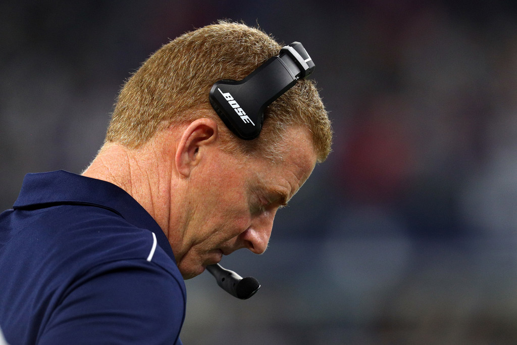 Former Dallas Cowboys head coach Jason Garrett stands on the sideline in the fourth quarter against the Buffalo Bills
