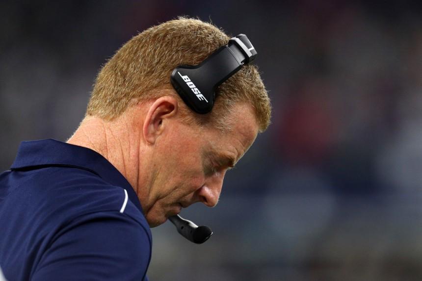 Former Dallas Cowboys head coach Jason Garrett stands on the sidelines against the Buffalo Bills