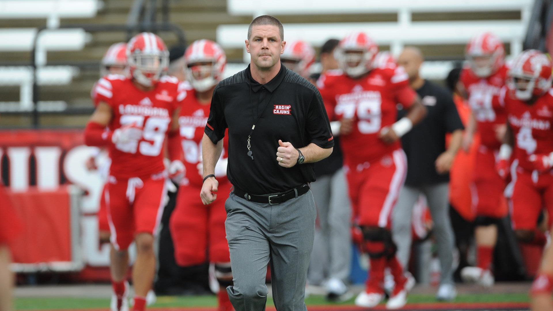 Louisiana Ragin' Cajuns head coach Billy Napier walks away from his team