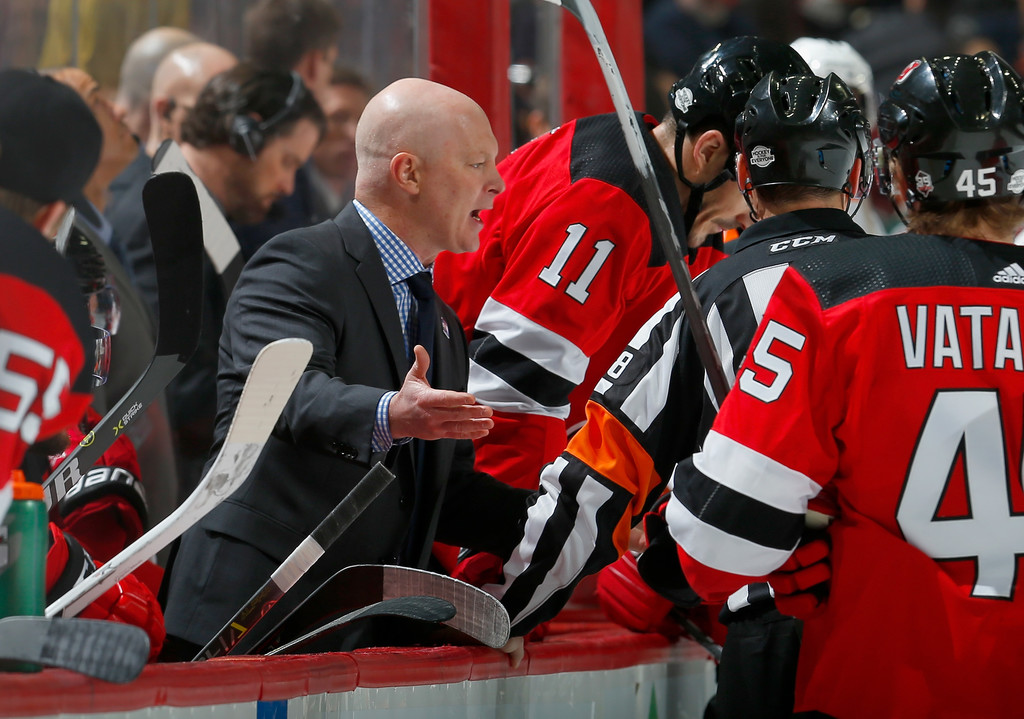 Former New Jersey Devils head coach John Hynes reacts to a call and argues with an official against the Philadelphia Eagles