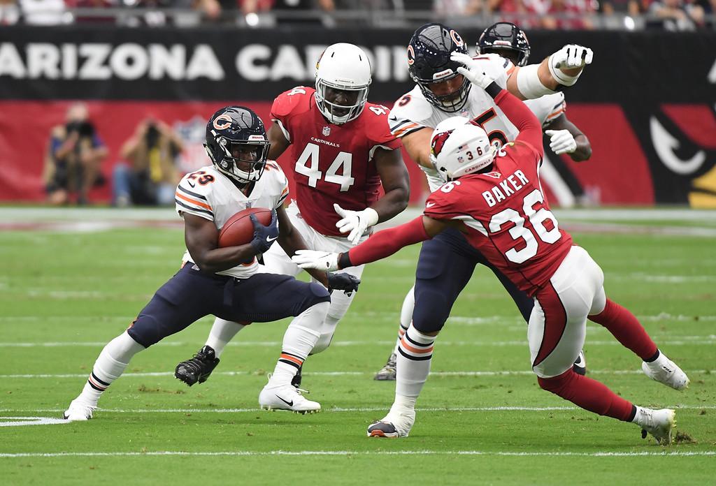 Chicago Bears offensive lineman Kyle Long blocks Budda Baker against the Arizona Cardinals as Tarik Cohen runs with the ball