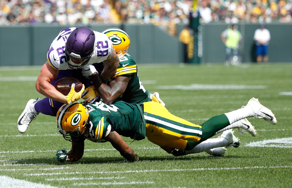Minnesota Vikings tight end Kyle Rudolph gets tackles by two Green Bay Packers defensive players
