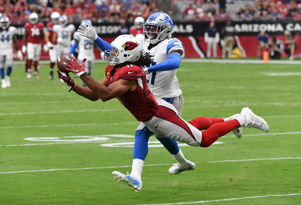 Arizona Cardinals wide receiver Larry Fitzgerald makes a diving catch while being defended by Tracy Walker against the Detroit Lions