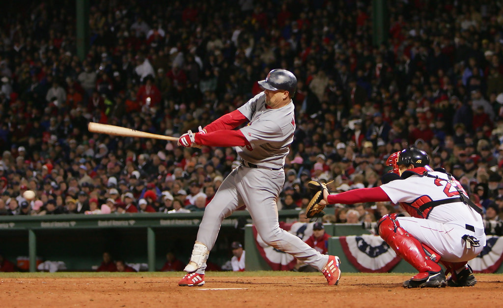 Former St. Louis Cardinals outfielder Larry Walker hits an RBI double in the sixth inning against the Boston Red Sox in Game One of the 2004 World Series