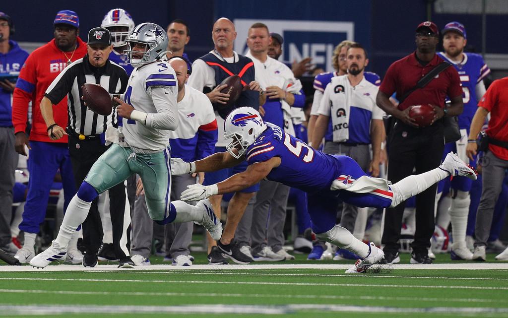 Buffalo Bills linebacker Lorenzo Alexander pursues Dallas Cowboys quarterback Dak Prescott as he runs with the ball