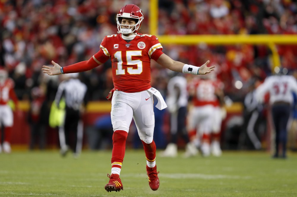 Kansas City Chiefs quarterback Patrick Mahomes II celebrates after throwing a touchdown in the NFL Divisional Round playoff game against the Houston Texans