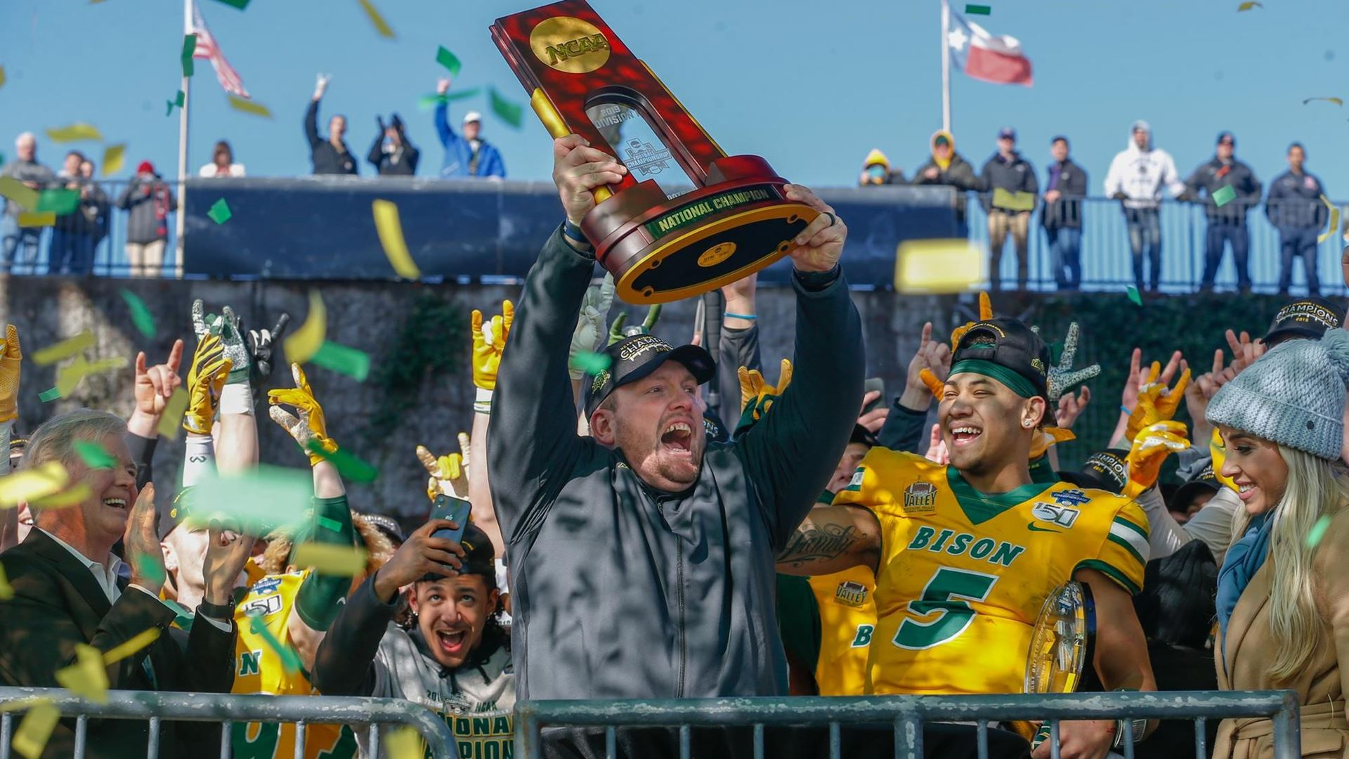 North Dakota State Bison head coach Matt Entz celebrating with the FCS National Championship trophy after a win over the James Madison Dukes