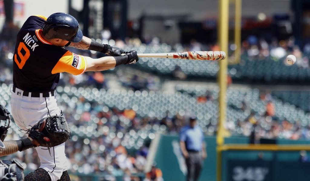 Former Detroit Tigers slugger Nicholas Castellanos hits a single against the Chicago White Sox
