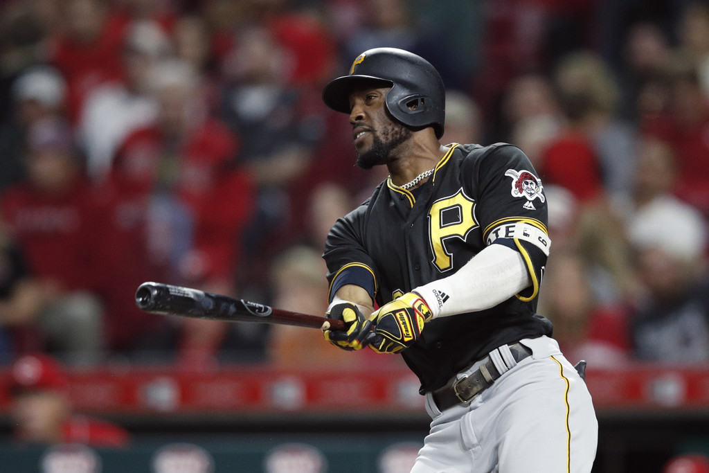 Former Pittsburgh Pirates outfielder Starling Marte hits a single to left field against the Cincinnati Reds