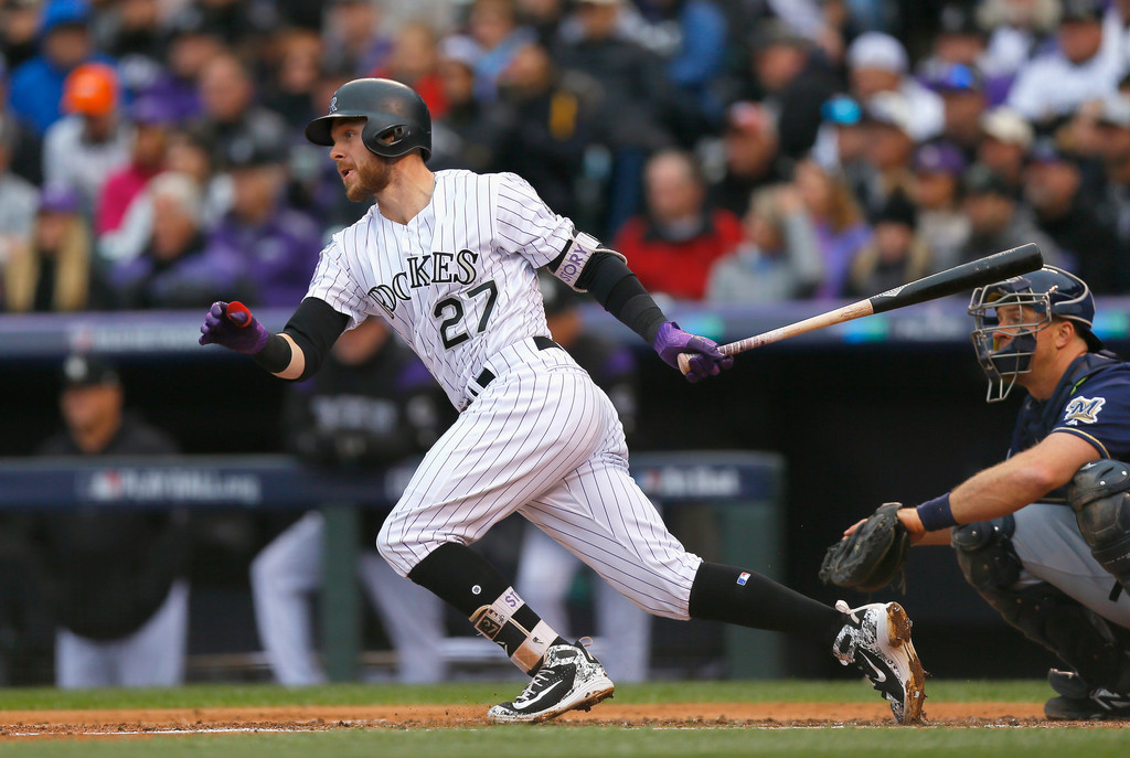 Colorado Rockies shortstop Trevor Story hits a single in the second inning of Game Three of the National League Division Series against the Milwaukee Brewers