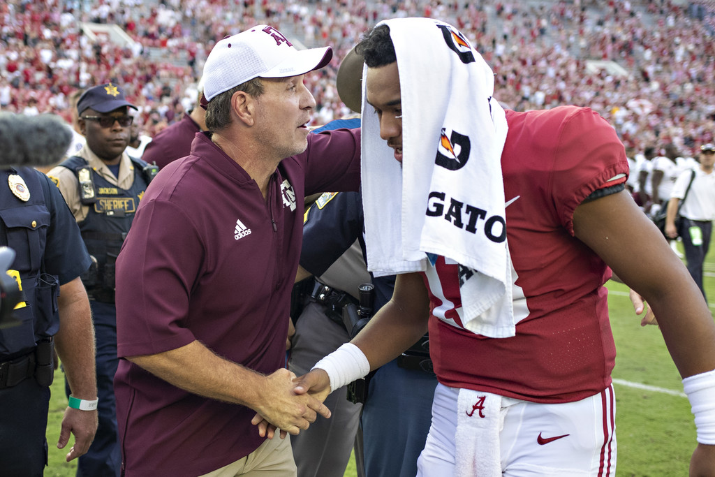 Texas A&M Aggies head coach Jimbo Fisher shakes hands with Tua Tagovailoa at the end of the game against the Alabama Crimson Tide